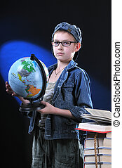 boy and globe - The boy of ten years in glasses gets on the...