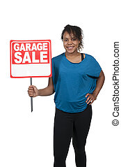 Garage Sale - Beautiful woman holding a garage sale sign