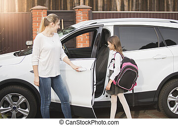 Mother meeting daughter after school lessons