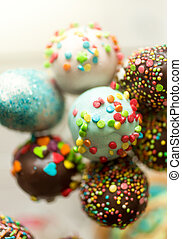 Macro photo of colorful homemade cake pops with sprinkles -...