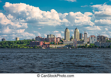 large buildings near the river summer day