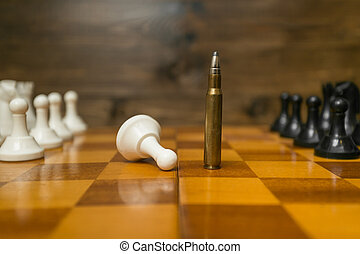 Riffle bullet on chessboard. Concept of power of guns -...