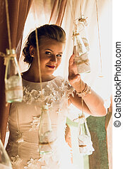 Toned portrait of beautiful bride posing with wedding...