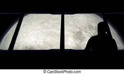 Astronaut Looks At Moon From Shuttle - Man goes to window of...