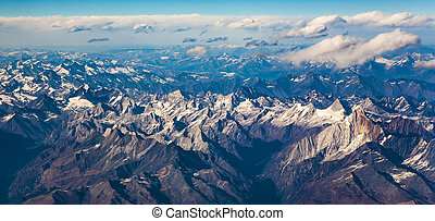 view from the aircraft to the mountains of the Himalaya -...