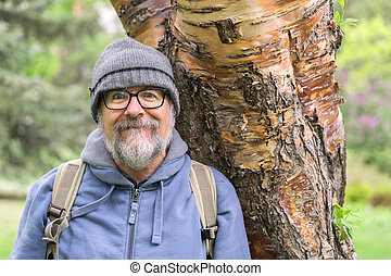 Baby boomer portrait with gray beard and mustache and...