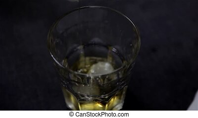 Glass of whiskey with ice HD