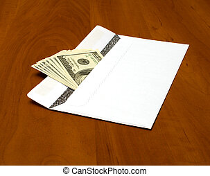 Graft. - Dollar bills in a white envelope on the office...