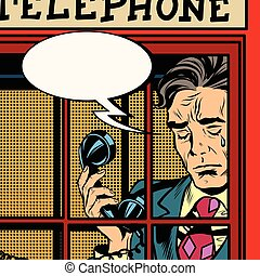 Retro man crying in the red phone booth