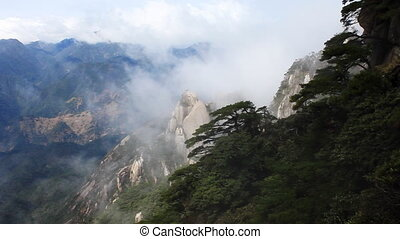 san 33 - clouds crossing over mountain in China