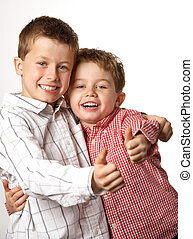 two young boys with thumbs up - two cute young boys arm in...