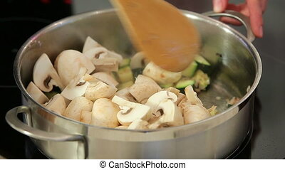 Cooking vegetable soup with champignon