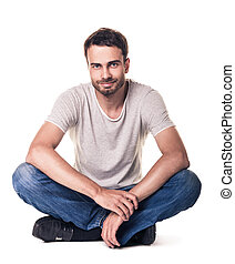 Casual young man sitting in lotus position - Casual young...
