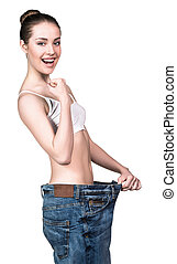 Woman wearing old big jeans - Woman became skinny and...