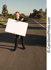 Businessman pointing on billboard - Happy businessman in...