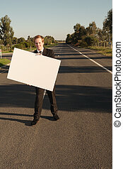 Businessman with billboard on road - Happy businessman in...