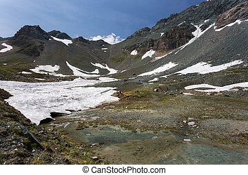 Mountain peaks covered with melting snow Spring in high...