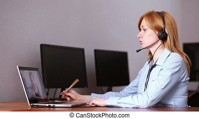 Female customer support operator. she leads online...