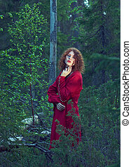 woman the mystical forest - Young woman in red dress in the...
