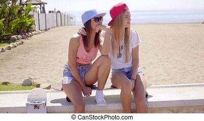 Two trendy young women with skateboards - Two trendy young...