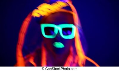 Man is dancing in neon clothes close up HD