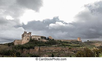 Monastery at Ucles, Castilla la Mancha, Spain cloudy sky -...