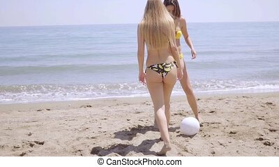 Happy young woman playing ball on the beach - Happy young...