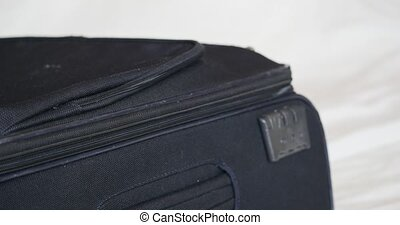 open baggage and zip out Suitcase Luggage - Close Up, Macro
