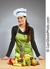 Woman cook with a bunch of fruits - Woman cook with a bunch...