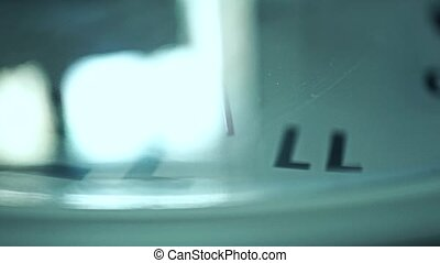 Macro video of rotating clock dial and moving second hand of...