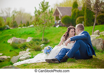 Young wedding couple enjoying romantic moments outside on a...