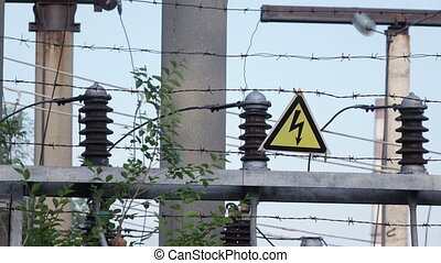 Barbed wire transformers with station - Danger sign and...