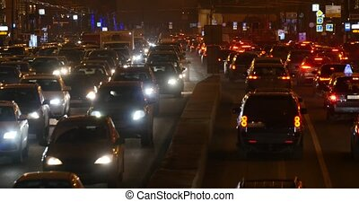 heavy traffic on the road at night
