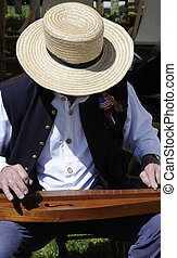 Civil War Actor Playing Dulcimer - Man in a straw hat plays...