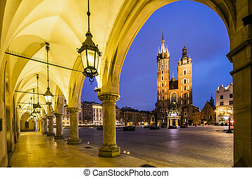 Krakow market square at dawn, Poland, Europe - Illuminated...