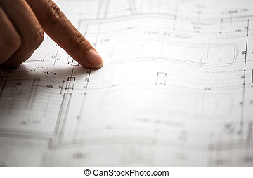 Pointing to specific place on architectural sketches of new...