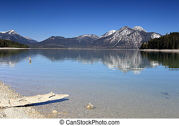 beautiful lake in bavarian landscape with blue sky