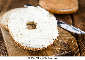 Cream cheese Bagel on wooden background - Cream cheese Bagel...