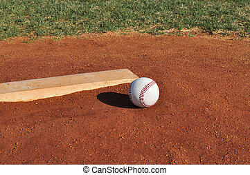 Baseball on the Pitcher\'s Mound Near the Pitching Rubber