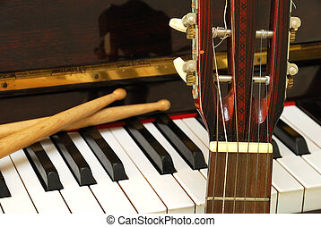 Drum sticks, guitar and piano keyboard. For concepts like...
