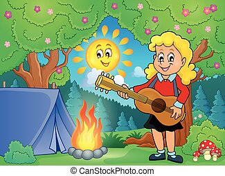 Girl guitar player in campsite
