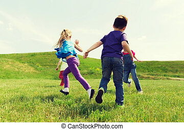 group of happy kids running outdoors - summer, childhood,...