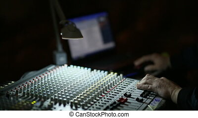 Professionals Hand Working On Audio Mixer In Studio