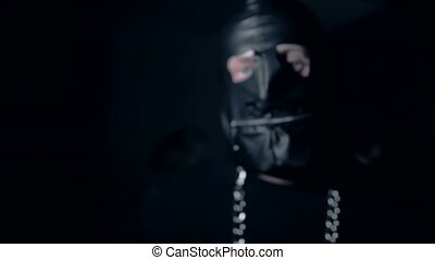 A man in a leather mask dances HD