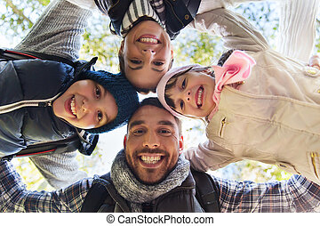 happy family faces outdoors at camp in woods - camping,...