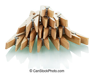 Pile of wooden clothespins isolated on white. - Pile of...