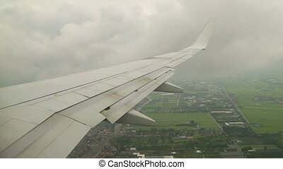 Flying on a plane - View from plane window during approach...