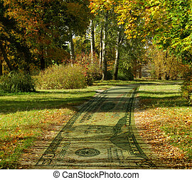 money road - money road in an autumnal park...