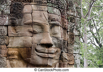 Face in Bayon Temple at Angkor - Stone face in Bayon Temple...