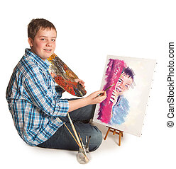 Painting a portrait - Teenager artist making a self-portrait...